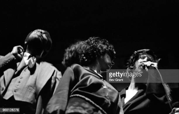 Lowangle view of three people one of whom speaks into a microphone on stage at the Filmore East during the venue's takeover by anarchist groups the...