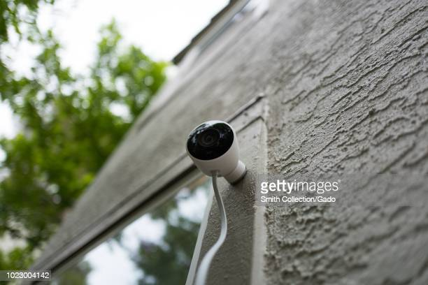 Lowangle view of weatherproof outdoor Nest home surveillance camera from Google Inc installed in a smart home in San Ramon California August 21 2018
