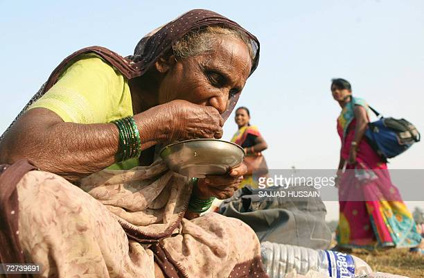 A lowcaste dalit or the oppressed Hindu woman eats rice at a homage site in Mumbai 06 December 2006 More than 200000 Hindus at the bottom of India's...