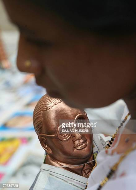 A lowcaste dalit or the oppressed Hindu woman holds a statue of B R Ambedkar at a homage site in Mumbai 06 December 2006 More than 200000 Hindus at...