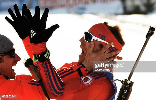 Lowell Bailey of the USA celebrates with his coach Bernd Eisenbichler after winning the Gold medal in the Men's 20km Individual competition of the...