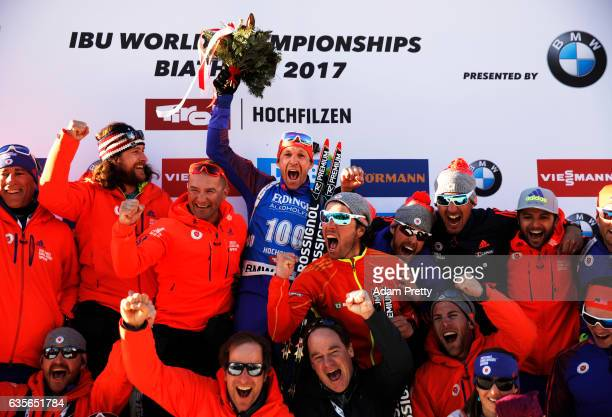 Lowell Bailey of the USA celebrates with his team mates and coaching staff and wife Erika after winning the Gold medal in the Men's 20km Individual...
