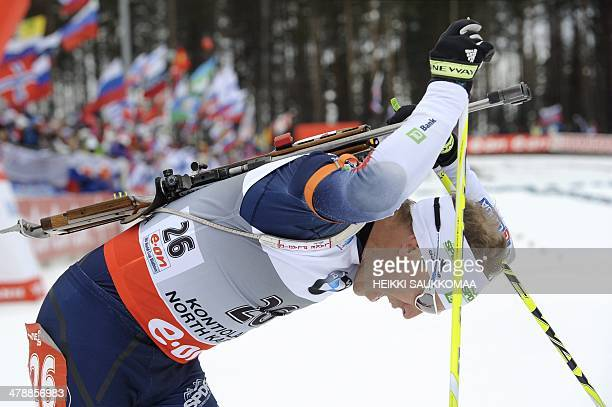 US Lowell Bailey reacts after the men's 10 km sprint competition of the IBU World Cup Biathlon event in Kontiolahti Finland on March 15 2014 Norway's...