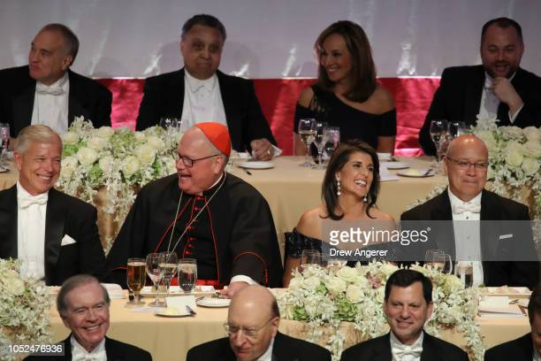 Lowell McAdam CEO of Verizon Archbishop of New York Cardinal Timothy Dolan US Ambassador to the United Nations Nikki Haley and her husband Michael...