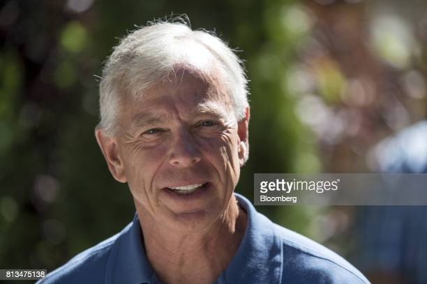 Lowell McAdam chairman and chief executive officer of Verizon Communications Inc walks the grounds after a morning session during the Allen Co Media...