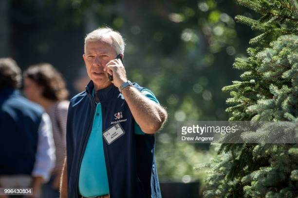 Lowell McAdam chairman and chief executive officer of Verizon Communications talks on his cell phone during the annual Allen Company Sun Valley...