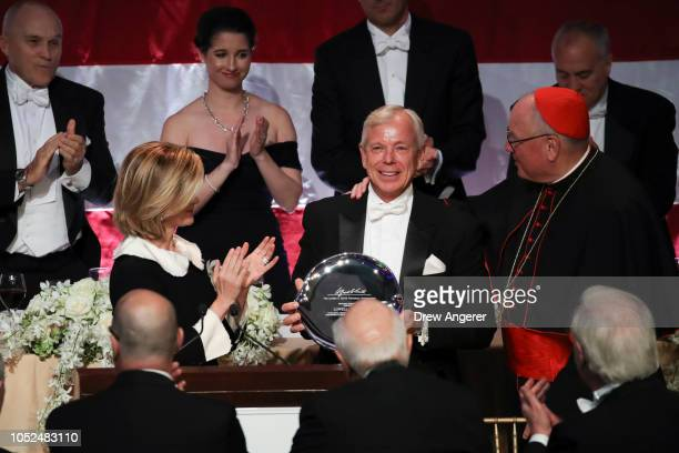 Lowell McAdam former CEO of Verizon is awarded with the 'Happy Warrior Award' from Archbishop of New York Cardinal Timothy Dolan at the annual Alfred...