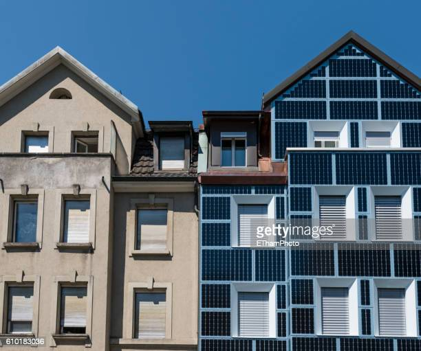 Low-energy residential house with solar cell covered facade