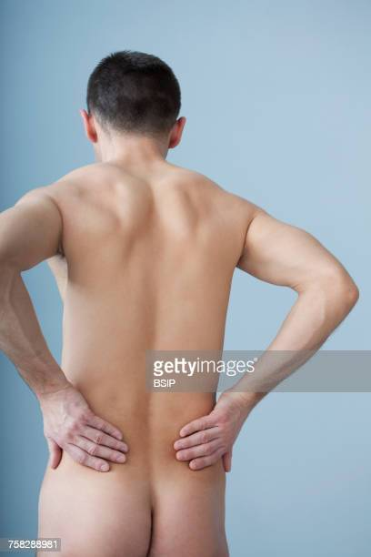 lower back pain in a man - lower back stock pictures, royalty-free photos & images