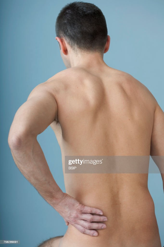 Lower back pain in a man : Stock Photo