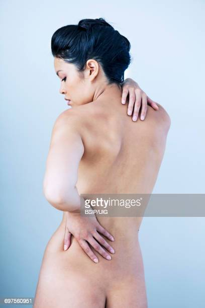 lower back pain in a woman - lower back stock pictures, royalty-free photos & images