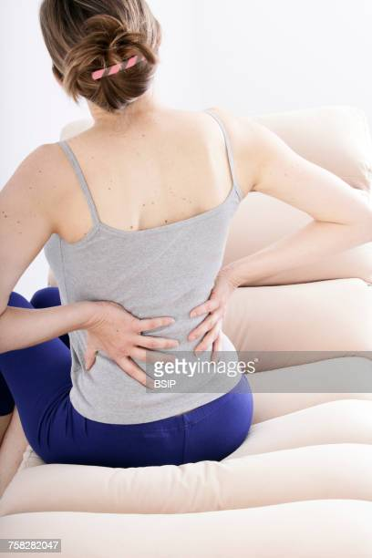 lower back pain in a woman - 下背部痛 ストックフォトと画像