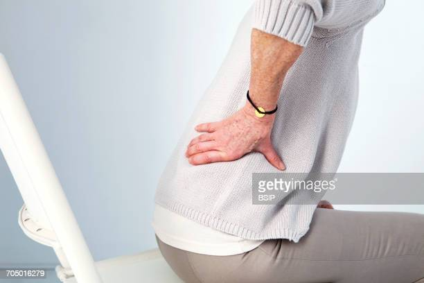 lower back pain in elderly person - 下背部 ストックフォトと画像