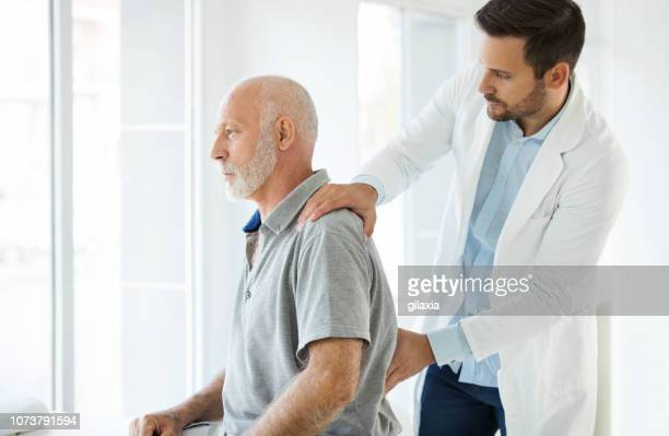 lower back pain medical examination. - hernia stock pictures, royalty-free photos & images