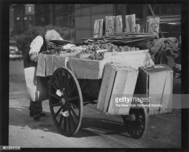 Lower East Side peddler on his way to the market, New York, New York, 1929.