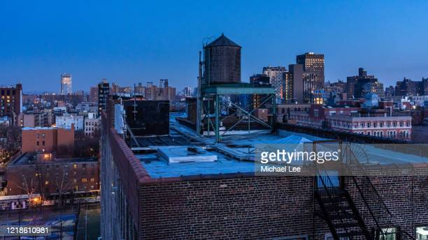 lower east side twilight view - new york - lower east side manhattan stock pictures, royalty-free photos & images