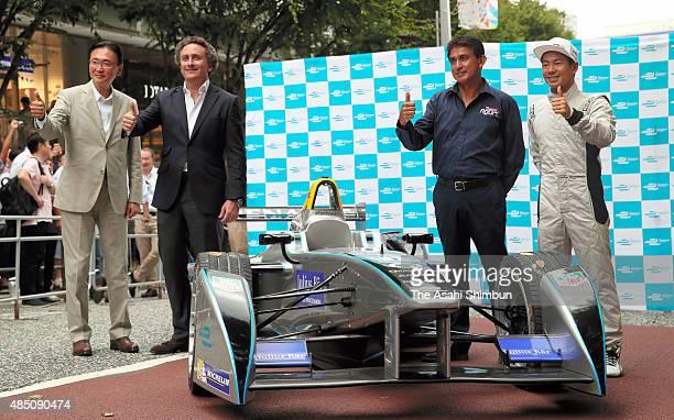 Lower House lawmaker Keiji Furuya Formula E CEO Alejandro Agag former Formula One driver Aguri Suzuki and driver Sakon Yamamoto pose for photographs...
