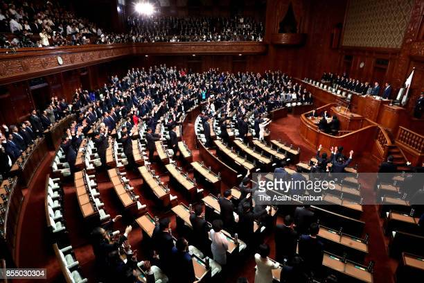 Lower House lawmakers make banzai cheer as Prime Minister dissolves at the Diet Building on September 28 2017 in Tokyo Japan Prime Minister Shinzo...