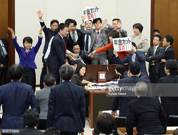 A lower house panel votes on a bill aimed at softening the impact of Japan's shrinking and graying population on the country's pension system on Nov...