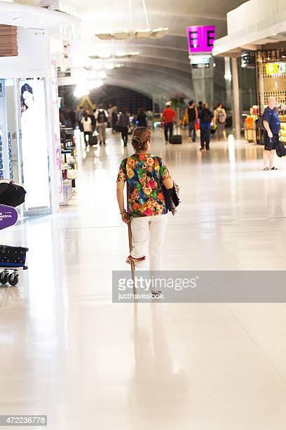 Lower leg amputated caucasian woman in airport Survanabhumi