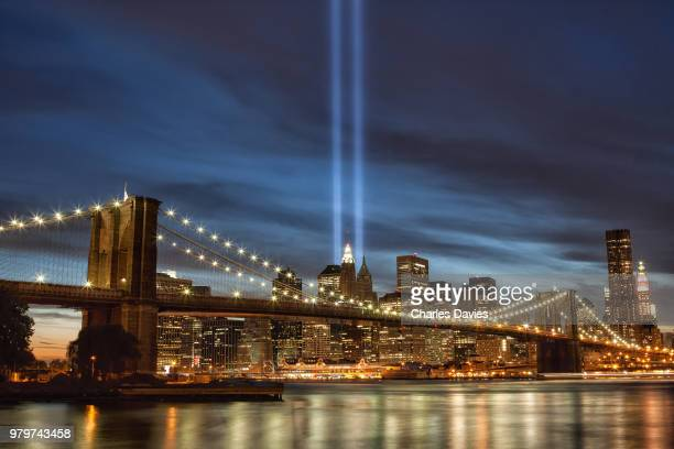 lower manhattan and one world trade center from brooklyn bridge park at night, new york city, new york state, usa - world trade center memorial stock pictures, royalty-free photos & images