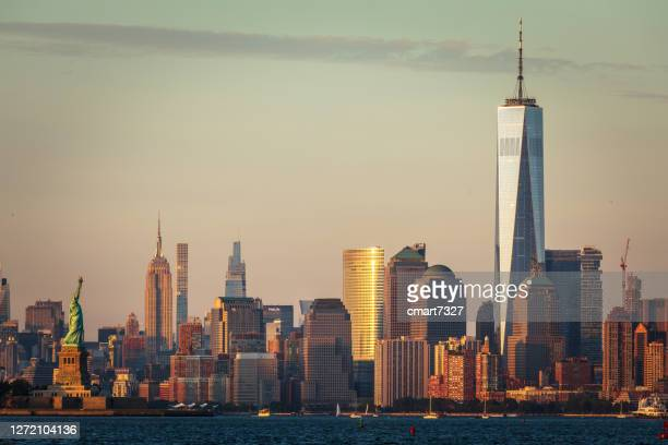 lower manhattan and statue of liberty - new york harbour stock pictures, royalty-free photos & images