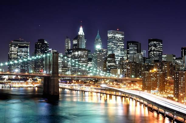 Lower Manhattan At Night From The Manhattan Bridge Wall Art