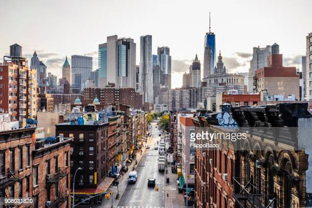 lower manhattan cityscape - chinatown - city life stock pictures, royalty-free photos & images