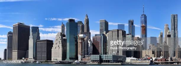 lower manhattan skyline as seen from the east river. manhattan, new york city, usa - マンハッタン ストックフォトと画像