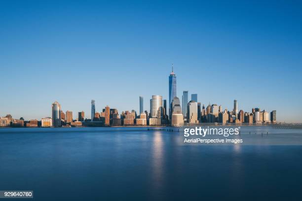 lower manhattan skyline, new york skyline at sunset - new york skyline stock photos and pictures