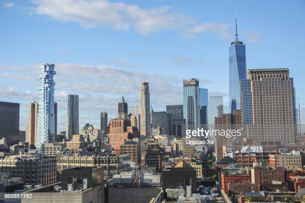 lower manhattan urban skyline from soho, new york city - soho new york stock photos and pictures
