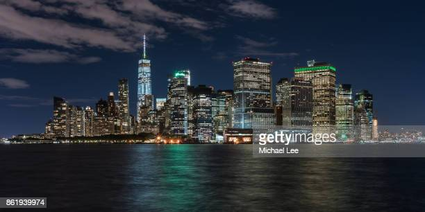 lower manhattan view from governors island - new york - new york skyline stock photos and pictures