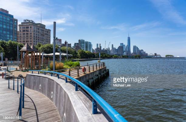 lower manhattan viewed from hudson river park - hudson river stock pictures, royalty-free photos & images