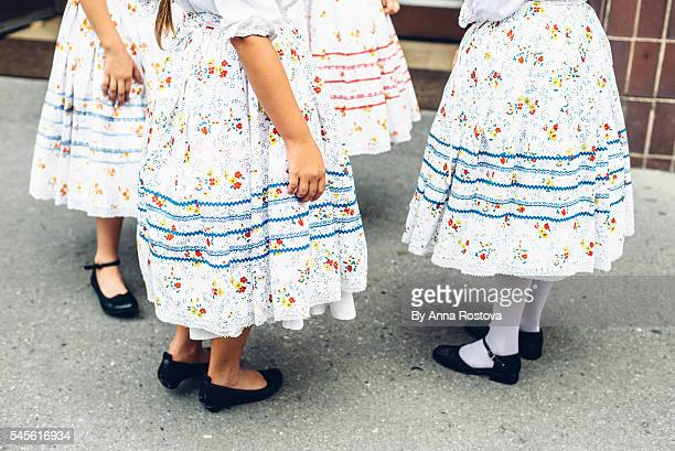 lower parts of preteen girls in hungarian traditional folk costumes - hungary stock-fotos und bilder