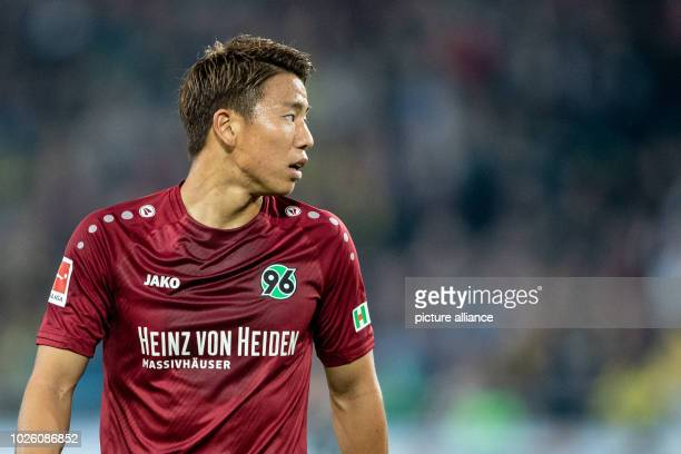 Soccer Bundesliga Hanover 96 vs Borussia Dortmund 2nd matchday in the HDIArena Hanover's Takuma Asano is on the field Photo Swen Pförtner/dpa