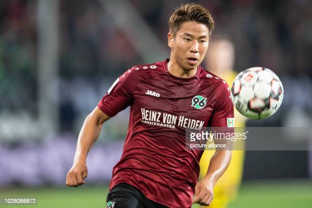 Soccer Bundesliga Hanover 96 vs Borussia Dortmund 2nd matchday in the HDIArena Hanover's Takuma Asano on plays the ball Photo Swen Pförtner/dpa