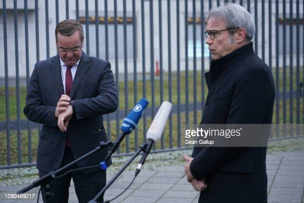 Lower Saxony state Interior Minister Boris Pistorius and Thuringia state Interior Minister Georg Maier speak to the media outside the Federal...