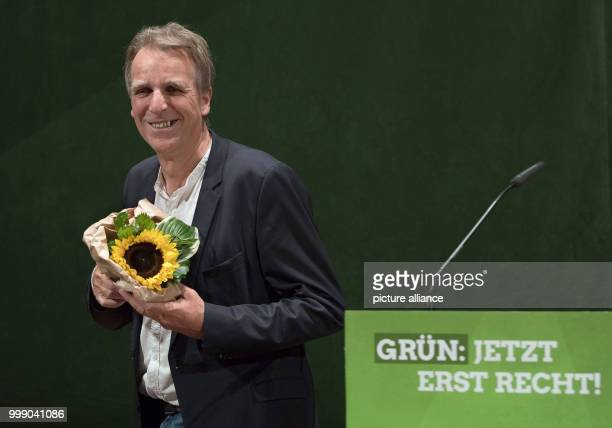 Lower Saxony's Minister of Environment and top candidate Stefan Wenzel stands on stage during the conference of state delegates of the Lower Saxony's...