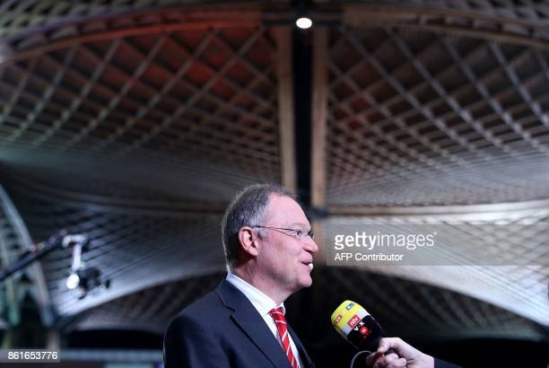 Lower Saxony's State Premier Stephan Weil of the Social democratic SPD party talks to the media in Hanover on October 15 2017 In the state vote in...