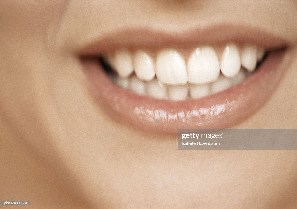 Lower section of woman's face, toothy smile, extreme close-up : Stockfoto