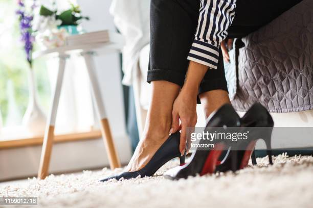 lower section of young woman trying on high heels - women trying on shoes stock pictures, royalty-free photos & images