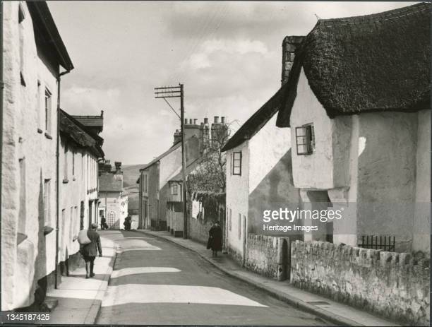 Lower Street, Chagford, West Devon, Devon, 1930s. The view looking north west along Lower Street with Bishops House in the right foreground. Artist J...