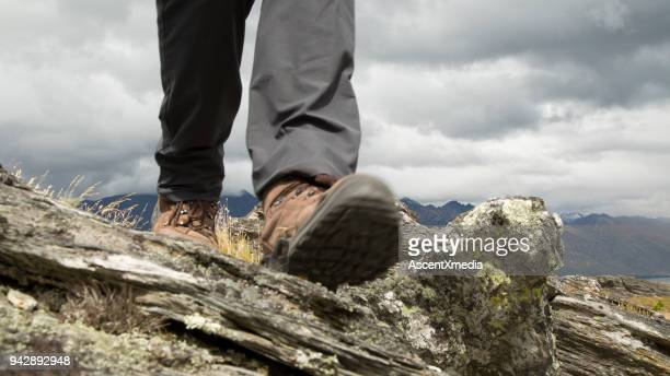 Lower torso of hiker on summit ridge