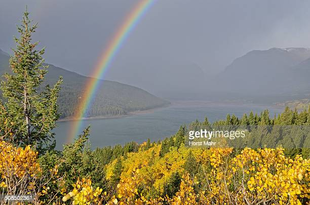 lower two medicine lake with rainbow, glacier national park, montana, usa - two medicine lake montana stock-fotos und bilder