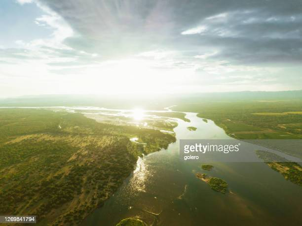 lower zambezi river at sunset hour - zambezi river stock pictures, royalty-free photos & images