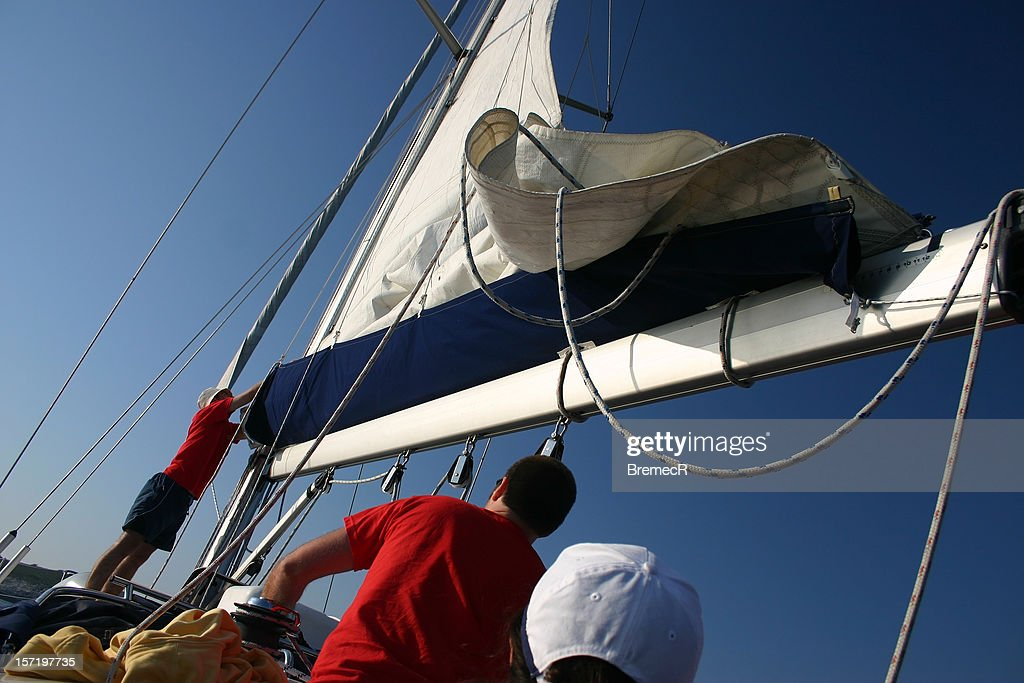 Lowering the sail : Stock Photo