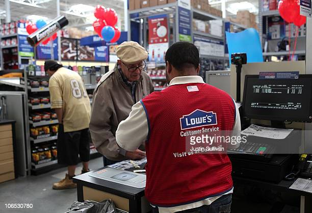Lowe's employee checks helps a customer during the grand opening of the Lowe's store on November 4 2010 in San Francisco California San Francisco...
