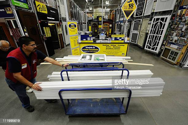 Lowe's employee helps a customer buying windows and window molding at Lowe's home improvement store on April 11 2011 in Burbank California The home...