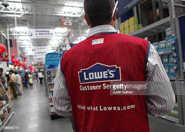 Lowe's employee walks through the store during the grand opening of the Lowe's store on November 4 2010 in San Francisco California San Francisco...