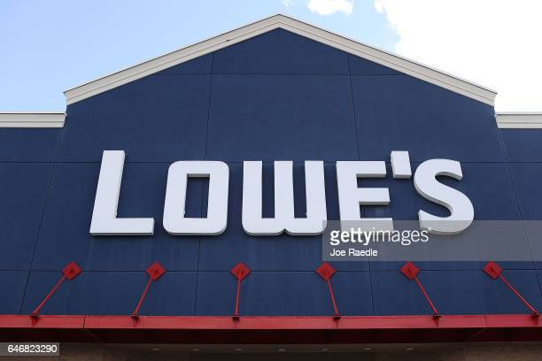 Lowe's sign is seen on the outside of a store on the day the company reported a rise in earnings on March 1 2017 in Hialeah Florida Lowe's reported...